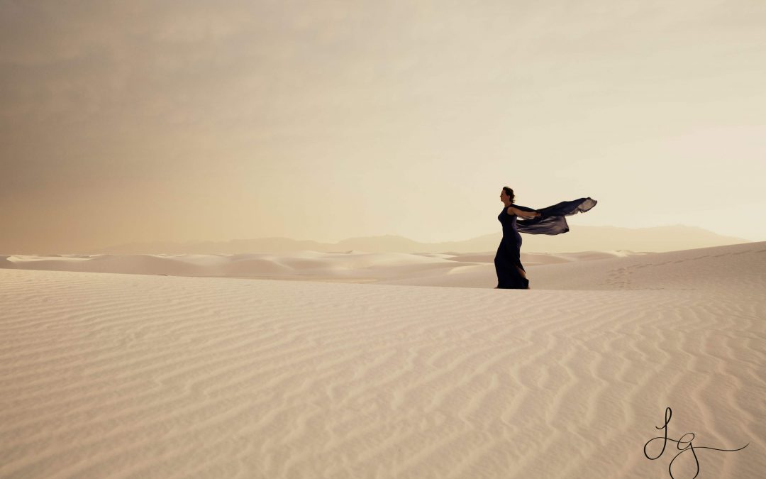 Woman in a dress in the desert for Strong Female Stories